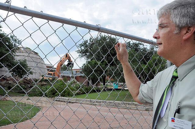 Planetarium Coordinator Bob Kelley looks as a crane removes roof debris July 10 on the west side of Scobee.   Photo by Ingrid Wilgen