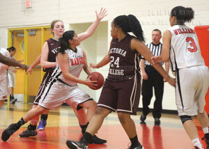 Fire science sophomore Jennifer Gonzales drives between Lady Pirate defenders Elissa Beaudoin and Jill Runnels to score during the Lady Rangers' 55-44 loss. Photo by Catharine Treviño