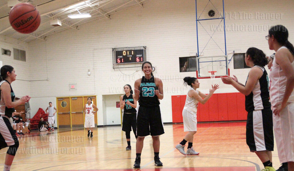 Journalism freshman Kendra Rainey of Palo Alto celebrates after sinking the winning free throw in the last seconds of Wednesday's game against the Lady Rangers in Gym 1 of Candler. Rainey scored 25 points in the 62-61 victory. Photo by E. David Guel