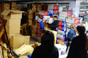 Students from this college form an assembly line to organize and inventory hundreds of boxes March 11 at A Wider Circle, a nonprofit organization supplying essential housing products to those in need in Washington, D.C. Photo by M.J. Callahan