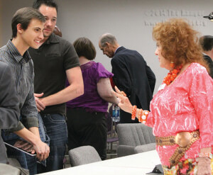 SGA President Andrew Hubbard talks with District 7 trustee Yvonne Katz after Tuesday's meeting. Photo by Melissa Perreault