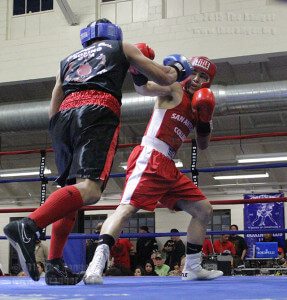 Oneill Fuentes from Randazzo Brothers Boxing Gym leans for a punch on drama freshman Dennis Salazar during the seventh bout in the preliminaries of the Golden Gloves tournament Feb. 18 at Woodlawn Gym at Alexander and Josephine Tobin. Fuentes won the one-minute match in the third round. The tournament continues through Friday  Photo by E. David Guel