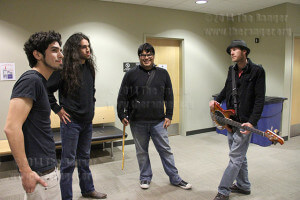 The Watching bandmates drummer Eric Martinez, lead singer Miguel Davila, lead guitarist John Michael, and bass guitarist Matt Craig anxiously await their first live performance on KSYM 90.1 FM Feb. 5. Photo by Belinda Hernandez