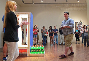 "Justin Korver, graduate student of sculpture at UTSA, is applauded after introducing his sculptures Feb. 20 in performing arts at Northeast Lakeview. ""Construction Counter 10: Counter Weight"" was designed for open interpretation, though he said it is about masculinity with the exterior man hard and tough, yet the subverted emotional side tender and warm. Photo by Daniel Carde"