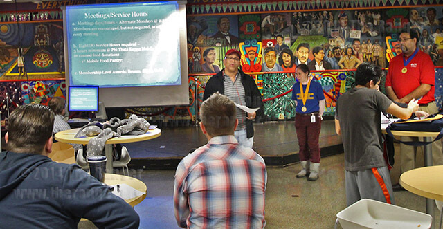 Reginald Smith, vice president of service of the Beta Nu chapter of Phi Theta Kappa, explains the rules for meetings and service hours to potential members during an orientation Feb. 12 in the Fiesta Room of Loftin. Chapter President Kim-Briana Lorine, center, and Vice President of Scholarship Eddiberto Silvaz, right, assist. The induction ceremony for Phi Theta Kappa is March 20 in McAllister. Photo by Catharine Trevino