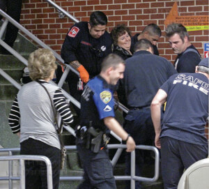 Paramedics carry math Professor Paula McKenna to a chair after she slipped on the stairs because the non-skid strips were worn Feb. 21 in McCreless. Photo by Mandy Derfler