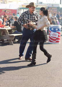 "Lupe Garcia and daughter Alexis smile and dance in the food court while several hundred others enjoy good eats and drink Saturday. He said, ""It's my dream to be dancing with my daughter."" Photo by Paula Christine Schuler"
