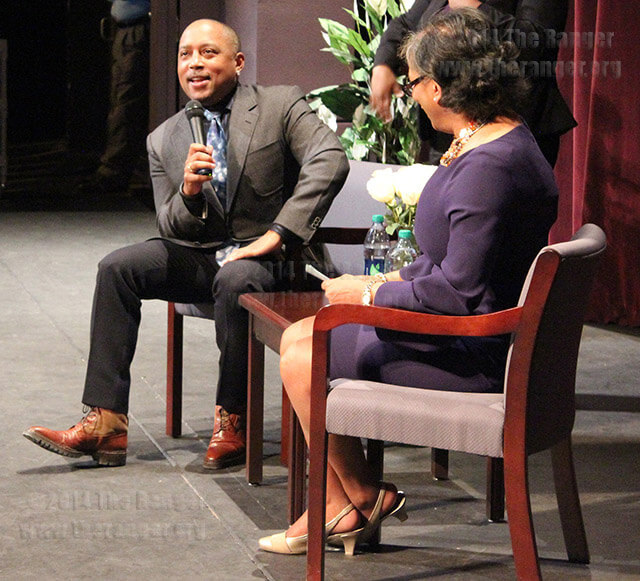 "Daymond John, entrepreneur and star of the television show ""Shark Tank,"" answers questions from Dr. Adena Williams Loston, president of St. Philip's College, during the President's Lecture Series Feb. 13 at Watson. John joined the cast of ""Shark Tank"" in 2009. St. Gerard Catholic High School students joined in with more than 600 attendees. Photo by Paula Christine Schuler"