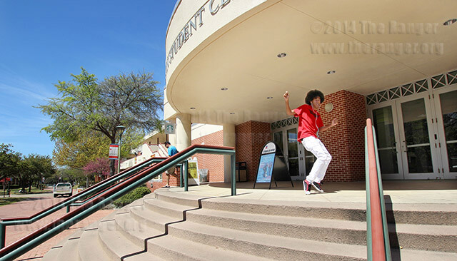 "Business management sophomore Donovan Lathan dances to We Are Toonz's ""Drop Dat NaeNae"" Tuesday south of Loftin. Lathan said he chose this spot because the floor is slick and he needed some sun. He has been dancing since he was 5 and typically dances three hours a day. Photo by Daniel Carde"