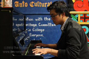"Engineering freshman Sirlance Nolasco plays a piano cover of Vanessa Carlton's ""A Thousand Miles"" Tuesday in the Fiesta Room of Loftin. Nolasco has been playing by ear since the age of 11 after taking two years of piano classes. Photo by Daniel Carde"