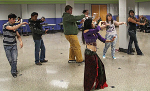 Belly dancer Paloma Sifuentes teaches students to dance Wednesday in the Fiesta Room in Loftin. The lessons were sponsored by student life and funded by the student activity fee. Photo by Riley Stephens