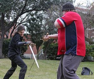 "Theater adjunct Joseph Urick and Brian Hill, drama sophomore and president of Drama Club, rehearse sword fight choreography for ""Cyrano De Bergerac"" before callbacks Feb. 5 at Bennett Music Hall. The play premieres 7:30 p.m. April 9 in McAllister auditorium. Photo by E. David Guel"