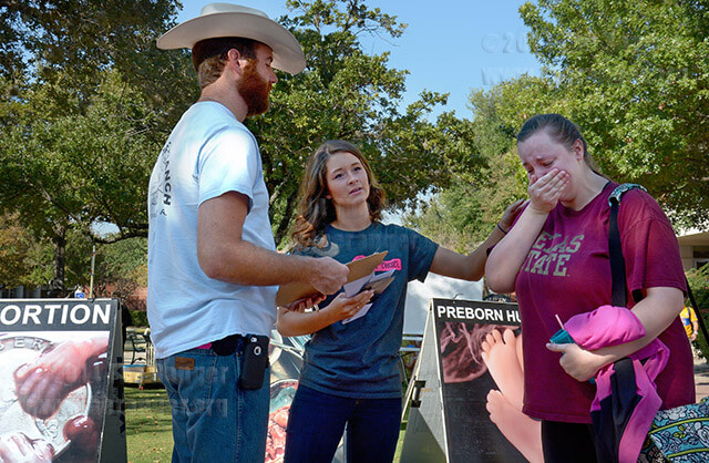 Lindsey Bell comforts mass communications sophomore Kelley Jaskinia, who began to cry as she talked about her stance against abortion Oct. 21 in the mall. Nate Hubert and Bell, volunteers for Love of Truth Ministries, will be in the mall today until 2:30 p.m. Their goal is to bring awareness and have an open dialogue with students about abortion. Photo by Neven Jones