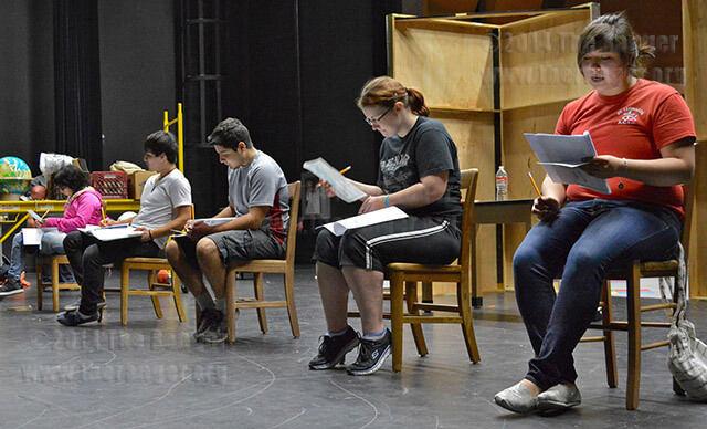 Drama sophomore Amber Perez, who plays pregnant teen Lala, reads aloud a question from the STAAR test during rehearsal Feb. 21 in the performing arts center auditorium at Palo Alto. Photo by Siobhan O'Donnell