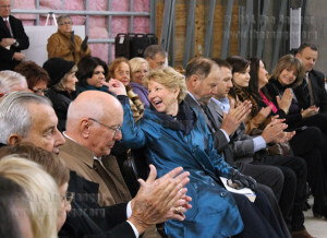 Dr. June Scobee-Rodgers smiles and gestures to audience members as they applaud Tuesday during a ceremony to honor the crew of the Challenger space shuttle in Scobee Education Center. Photo by Carlos Ferrand