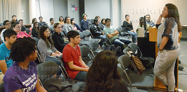 Magaly Chocano, CEO of SWEB Development, tells students being driven allowed her to start her own app developing company even though she had no background in technology. Chocano spoke during Women's History Month Wednesday in visual arts. Photo by Siobhan O'Donnell