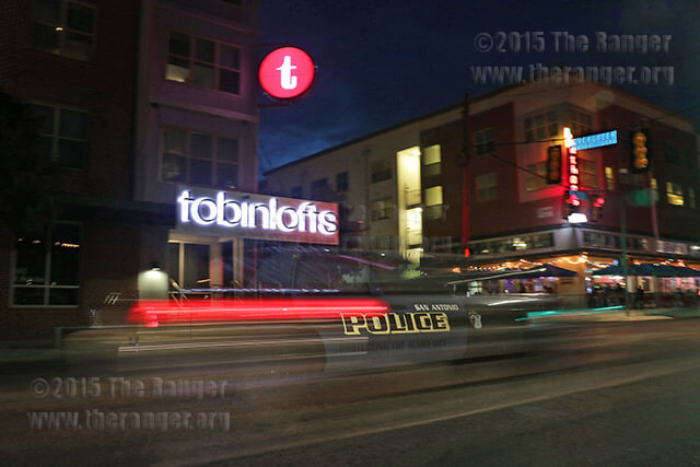 A San Antonio police officer drives by the front of Tobin Lofts Sept. 10 on Main Ave. Tobin has seen an increase of burglaries, thefts, assaults and public intoxication incidents in the past eight months. Photo by E. David Guel