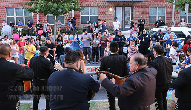 Students, faculty, Alamo Colleges police officers and community members enjoy mariachi Los Galleros Oct. 6 during this college's first National Night Out hosted by the Alamo Colleges police department on West Evergreen and North Main. About 250 attendees partook in free food, raspas and drinks at the block party promoting community-building against crime. Photo by E. David Guel