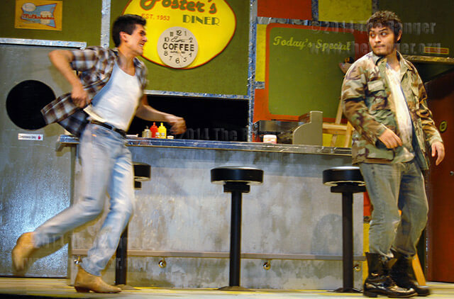 """Stephan, played by theater freshmen Esau Perez, lunges forward with a knife to attack Teddy, played by theater freshmen Eric Alvarado, Feb. 12 during a dress rehearsal of """"When You Comin' Back, Red Ryder?"""" The production continues at 7:30 p.m. today and Saturday and 2:30 p.m. Sunday in McCreless. Photo by Eric M. Valdez"""