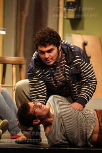 "Teddy, played by theater freshman Eric Alvarado, terrorizes hostage Stephen, played by theater freshman Esau Perez, Tuesday in McCreless theater during rehearsal of ""When You Comin' Back, Red Ryder?""  Photo by Roberto Villarreal"