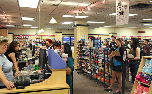 Accounting sophomore Jamie Mendez waits in line to purchase a spiral notebook Monday, the first day of classes, in the college bookstore in the basement of Loftin. The bookstore's hours are 7:45 a.m.-6 p.m. Monday through Thursday and 7:45 a.m.-2 p.m. Friday. Mendez said she is excited classes have started so she can return to keeping busy.  Photo by Daniel Carde