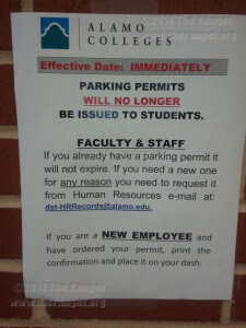 A sign posted on the Business office window in the Fletcher Administration building informs students and factually about changes to parking decal policy.