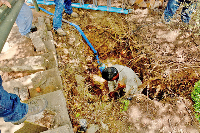 Contractors from JCH Construction dig on the north side of Candler. A water main break caused facilities to turn off the water in Candler, Gonzales, McCreless and Loftin yesterday morning to isolate the source of the leak. The extent of the problem remains unknown until the contractors finish digging. Photo by Neven Jones