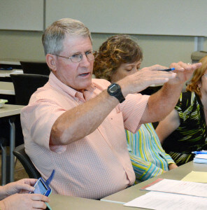 History Professor Mike Settles says the district's current payroll model is top heavy during the Faculty Senate meeting Aug. 27 in Room 218 of the nursing complex. Settles added that in the end students are suffering.