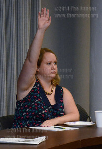 Celita DeArmond, reference and distance librarian raises her hand to ask a question during a special Faculty Senate Q and A with Chancellor Bruce Leslie Wednesday in visual arts. DeArmond told Leslie she reviewed a video of 2012 board meeting where the board approved summer work to be voluntary. She said the new policy might be going against districts will.  Photo by Neven Jones
