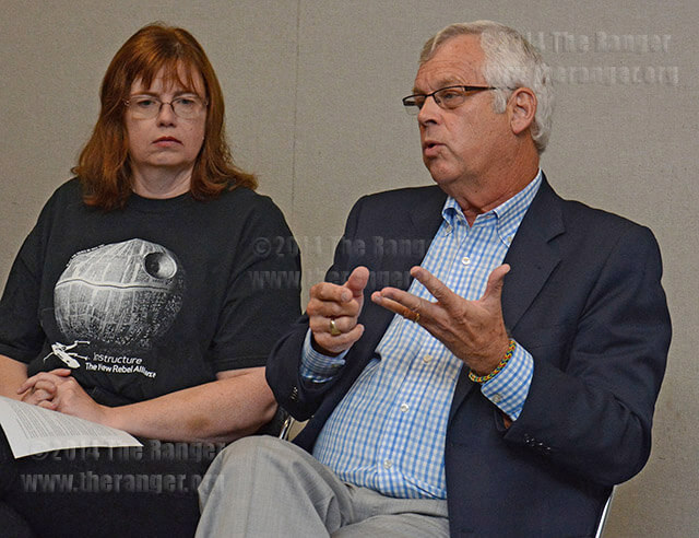 "Chancellor Bruce Leslie asks faculty to please stop referring to the board as the ""death star"" during a special Faculty Senate Q and A meeting Wednesday in visual arts. The death star, as depicted in Faculty Senate president Dawn Elmore's shirt, is a fictional weapon with the ability to blow up entire planets used by the Empire against the Republic in the Star Wars movies.  Photo by Neven Jones"