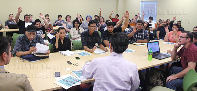 Mike Flores, president at Palo Alto College, asks students and faculty to raise their hands if they plan to transfer to a four-year university Thursday during a open forum in Room 119 of Guadalupe Hall at Palo Alto College.  Photo By Adriana Ruiz