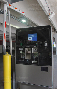 Unused kiosk and barrier arms in parking garage  Adriana Ruiz