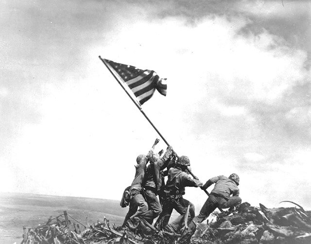 Photographer Joe Rosenthal's Pulitzer-winning photograph captures five U.S. Marines and a U.S. Navy corpsman raising the second flag Feb. 23, 1945, on Mount Suribachi during the Battle for Iwo Jima.