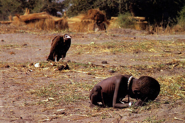 Photographer Kevin Carter's 1994 Pulitzer-winning photograph shows a starving toddler trying to reach a feeding center in Sudan. Carter did not help the young girl, and he committed suicide three months later.