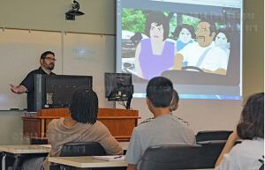 "Robert Gonzales presents his animated series ""Ernie"" to students in Room 218 of the nursing complex for Hispanic Heritage Month. Gonzales' animation won an award in the Neighborhood Film Project 3.0 for the South Side category. Gonzales attended San Antonio College in 1991.  Photo by Manuel Bautista Macias"