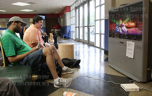 Video game design freshman Trevin Flowers and accounting sophomore Michael Heitz play Super Smash Bros. Brawl on a Wii Thursday in the Cyber Cafe on the second floor of Loftin. They lost the brawl to the computer's avatar. Cyber Cafe is open 8 a.m.-5 p.m. Monday through Friday, and gaming systems may be checked out from the Office of Student life with a Banner ID.  Photo by Daniel Carde