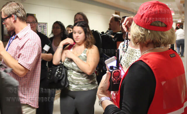 Lauri Metcalf, American Sign Language and interpreter training chair, watches as students file out of Nail after completing a severe weather evacuation drill. The drill simulated a tornado in effect and lasted about 40 minutes. All floors had evacuation leads who distinguished themselves with red caps and vests. Students from each floor waited in the basement of Nail until the evacuation management coordinator, Jacqueline Silva notified the team that students could return to classes. Several buildings of this college were involved in the drill including the chemistry and geology building.  Photo by R. T. Gonzalez