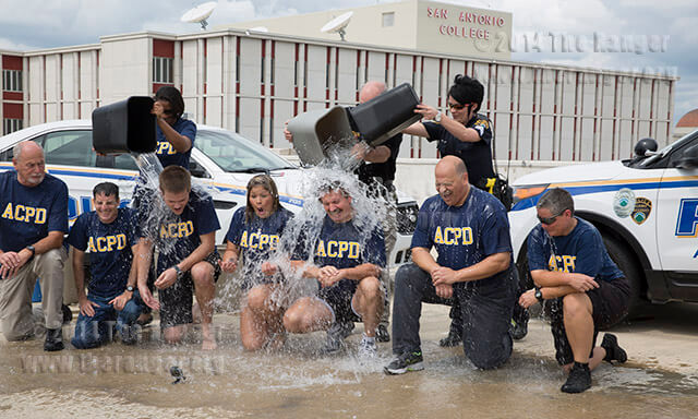 "Police chief Don Adams gets splashed with ice water along with six members of the Alamo Colleges Police Department for the ""Ice Bucket Challenge"" today on the fifth floor of the old parking garage south of Moody at the corner of East Loop and West Myrtle. Participants raise awareness for Amyotrophic lateral sclerosis by having a bucket of ice water poured on them or by making a donation to the ALS association. The association has received more than $100 million in donations since the challenge began.  Photo By Daniel Carde"