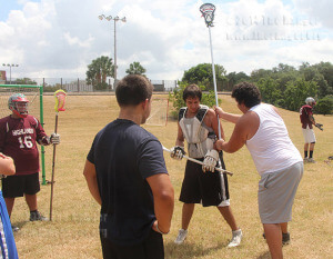 Culinary arts freshman Joshua Wells and fire science freshman Noel Andujo show lacrosse players from this college and Highlands High School which body areas are penalties to touch Saturday during a lacrosse practice at San Pedro Springs Park west of McFarlin Tennis Center.  Taylor Tribbey