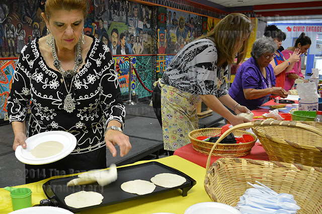 "Patsy Liedecke flips a tortilla during ""Cooking with Mama,"" a Hispanic Heritage Month event Wednesday in the Fiesta Room of Loftin. This year Liedecke's mother Esther Morales Liedecke brought a group of ""mamas"" with her to teach tortilla-making.  Ayesa Hinojosa"