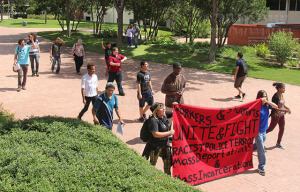 "Students from Documentaries for Social Justice protest through this campus today against racism, deportation and incarcerations happening around the U.S. The students chanted phrases such as ""Deportations mean we've got to fight back"" and ""Racism means we've got to fight back."" Photo By R.T. Gonzalez"
