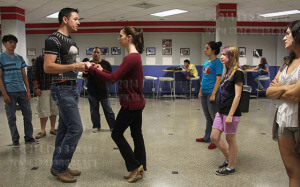 Psychology sophomore Jacob Wong and Karen Elliot, American sign language sophomore, demonstrate body positioning for merengue to students during a salsa dance lesson Monday in the Fiesta Room of Loftin. Wong taught students the basics of salsa dancing and how a male should lead the female. Photo By E. David Guel