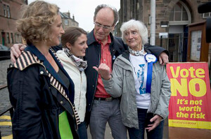 Scottish independence supporter Isabelle Smith, 83 of Edinburg, Scotland, poses for a photograph with her family outside a polling place in Edinburgh.  AP Photo