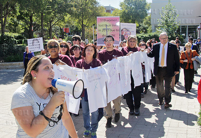 "Dental assisting sophomore Stephanie Contreras leads a chant of ""speak up!"" with students, staff and faculty from this college in a march against domestic abuse Oct. 15 that began in the women's empowerment center and ended in the Fiesta Room of Loftin. Volunteers and staff from the women's empowerment center held a clothesline with decorated T-shirts attached. Read the story online.  file"