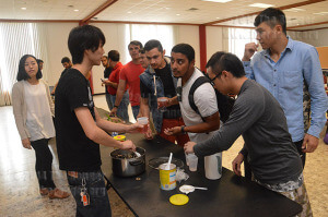 Vince Tung, UIW business economics senior serves Taiwanese Bubble Tea to Khales Mulla, UIW business administration sophomore, Oct.22 in UIW's Marian Hall Ballroom during the Asian Tea and Coffee Culture sponsored by the Asian Club.  Javier Hernandez