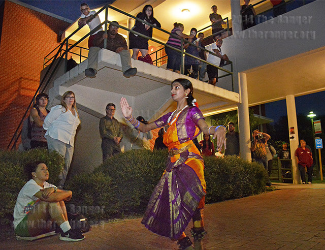 Dancer Ahagha Prasad, 13, performs a classical dance of South India called Bharatanatyam Wednesday between Gonzales and McCreless halls for Diwali, a festival of lights celebrating good over evil. Ahagha has been dancing for seven years.  Photo by Neven Jones