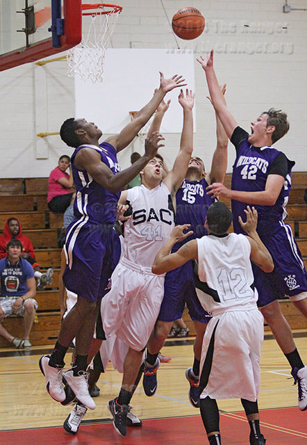 Criminal justice sophomore Alan Del Valle, right, reaches for a tip-in attempt over players from both teams in the first half of Wednesday's game against the Rangers in Gym 1 of Candler. Northwest Vista came out on top 66-58. Del Valle led the Wildcats with 15 points. The Rangers will face-off against the University of the Incarnate Word Cardinals 6 p.m. Oct. 22 in Gym 1 of Candler. Read the story online.  Photo by E. David Guel