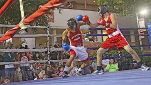 English freshman Jason Velasquez blocks a punch from architecture freshman Josue Gallardo in the fourth bout of the 10-bout, Olympic-style boxing showcase. Velasquez won the match after three rounds.  Photo by E. David Guel