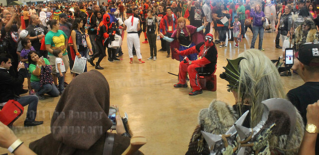 "Stephanie Padilla, cosplay actress, dressed as ""Anna"" from ""Frozen,"" sings along with Jack Williams, dressed as ""Deadpool,"" Sept. 27 during Alamo City Comic Con at the Henry B. Gonzales Convention Center. Williams called her over as he began Demi Lovato's version of ""Let It Go."" He coaxed her into singing while he gestured along.  Photo by Christopher A. Hernandez"