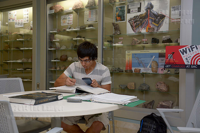 Engineering sophomore Israel Rodriguez studies chemistry Oct. 20 in the geology museum located in Room 003 of chemistry and geology.  Photo by Neven Jones